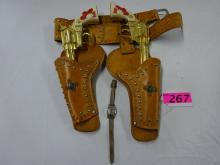 HOP A LONG CASSIDY LEATHER HOLSTER AND 2 CAP PISTOLS & WATCH