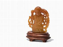 Amber colored Stone Carving of a Boy with Lotus, Qing