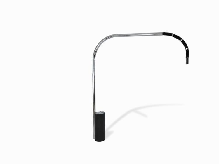 Chrome standing lamp with curved arm