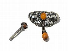 Two Skonvirke Silver Brooches with Amber, Denmark, around 1910