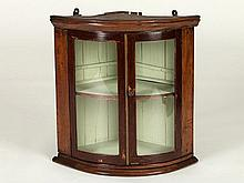 Small, rounded corner showcase with glazed doors, 19th C