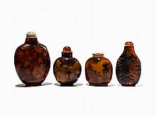 4 Snuff Bottles of Amber, Resin and Glass, 20th C.