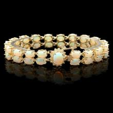 Lot 58: `14k Gold 14.00ct Opal & 0.50ct Diamond Bracelet