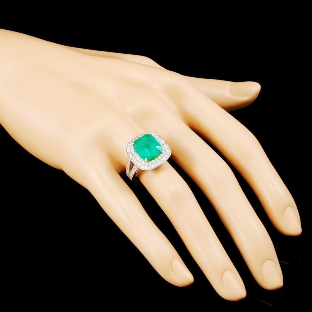 Lot 40: 18K Gold 5.50ct Emerald & 1.09ctw Diamond Ring