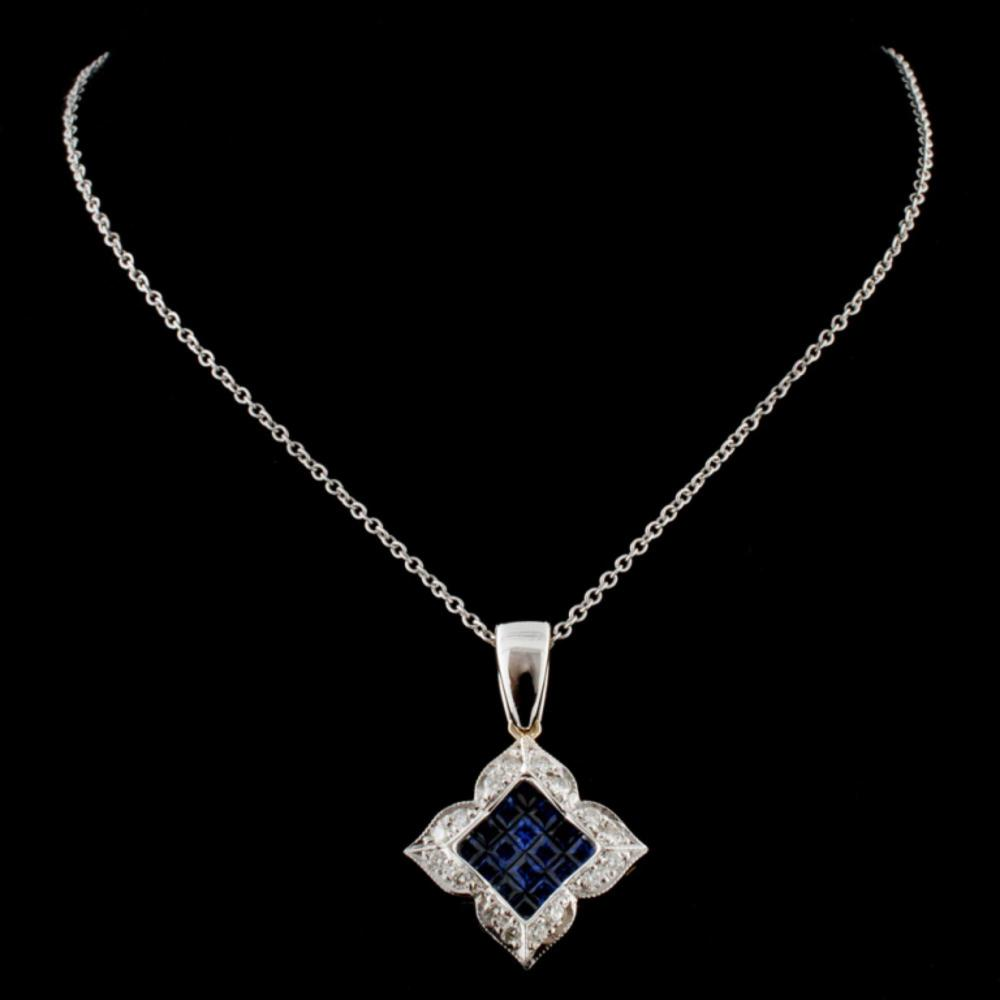 Lot 70: 18K Two Tone 0.91ct Sapphire & 0.25ct Diamond Pend