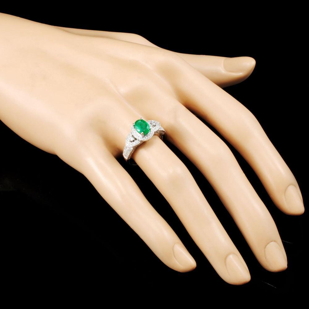 Lot 73: 18K Gold 0.71ct Emerald & 0.48ctw Diamond Ring