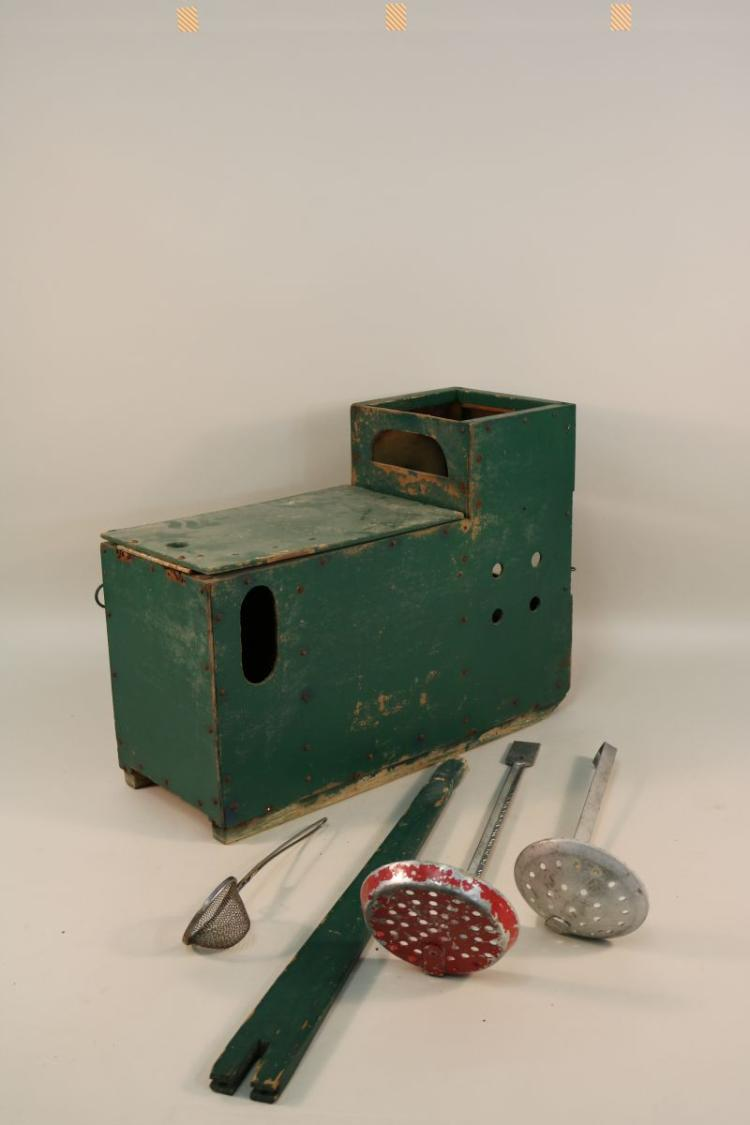 Vintage wooden ice fishing sled box set up to be used as a for Ice fishing setup