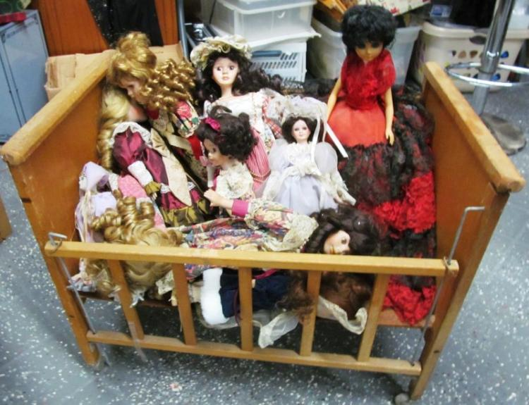 WOOD DOLL BABY BED FULL OF DOLLS