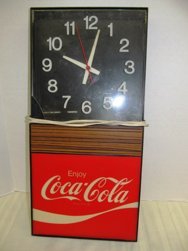 VINTAGE COCA-COLA CLOCK ~ Note: see photo for chip in cover of face.  Being sold as-is ~ no bulb & clock is working off and on
