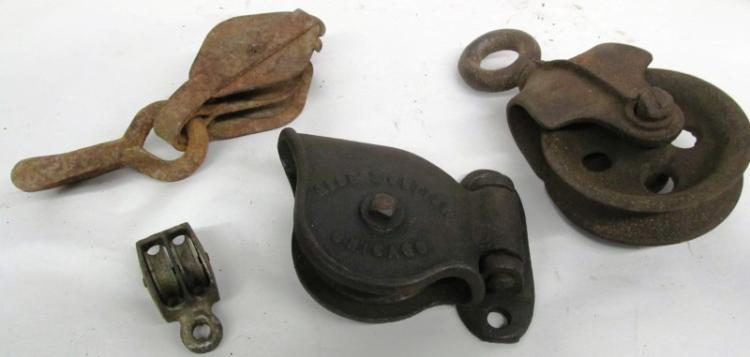 T-8 LOT OF 4 METAL PULLEY'S