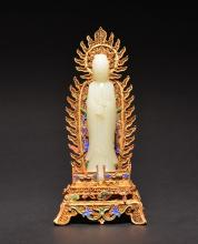 A WHITE JADE CARVING OF GUANYIN AND STAND , Qing Dynasty