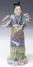 CHINESE FAMILLE ROSE PORCELAIN FIGURE WITH PEACHES