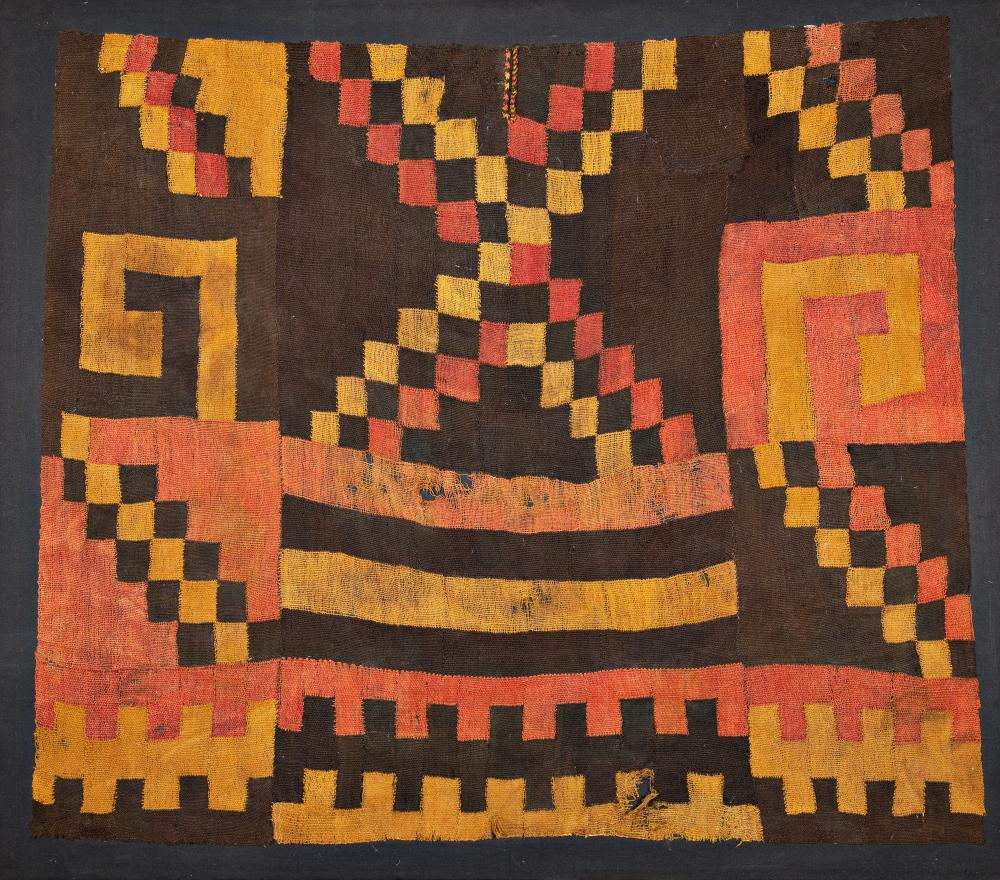 Cape with geometric motifs