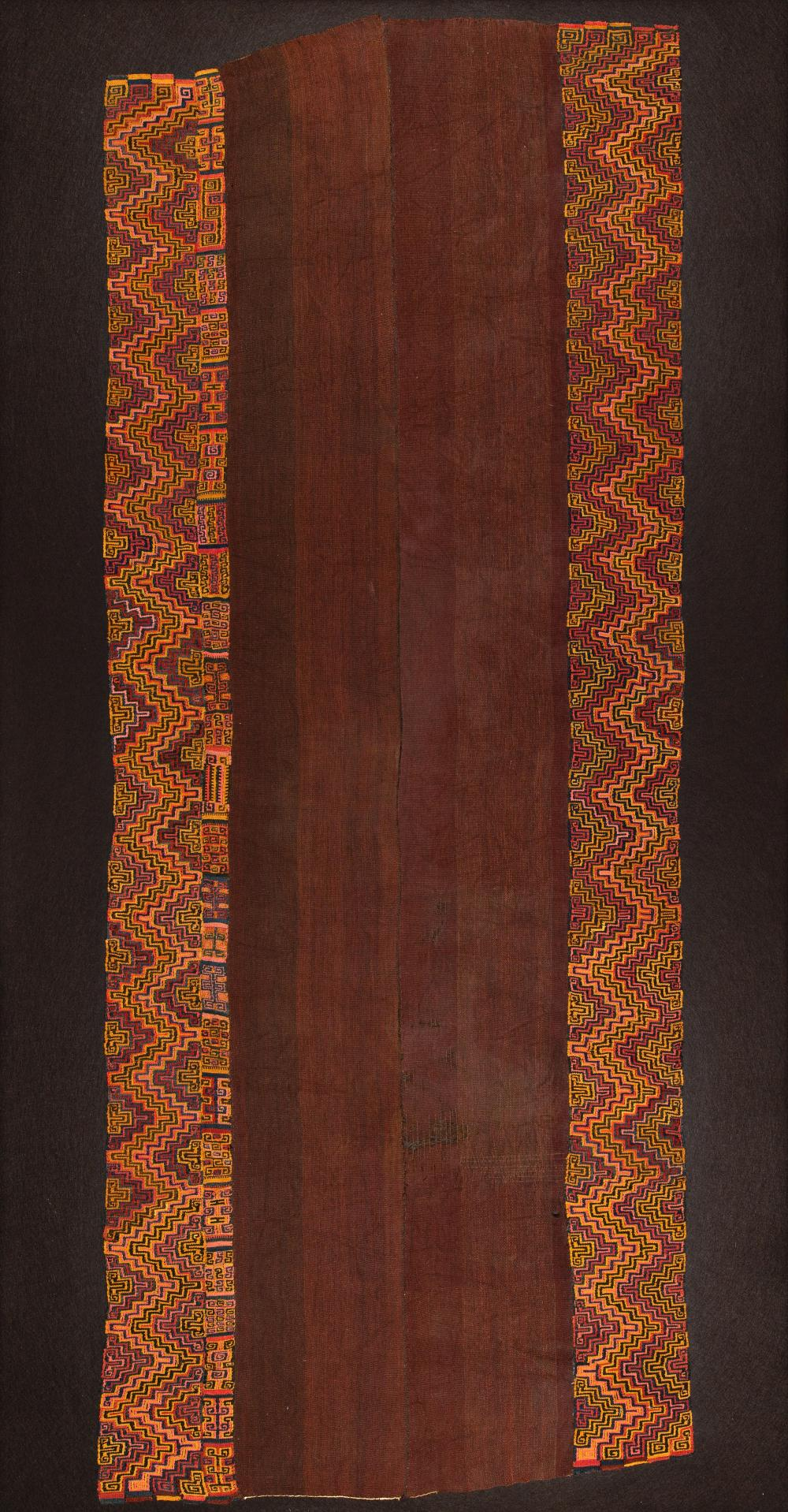 Ceremonial garment woven in two parts with decorative border