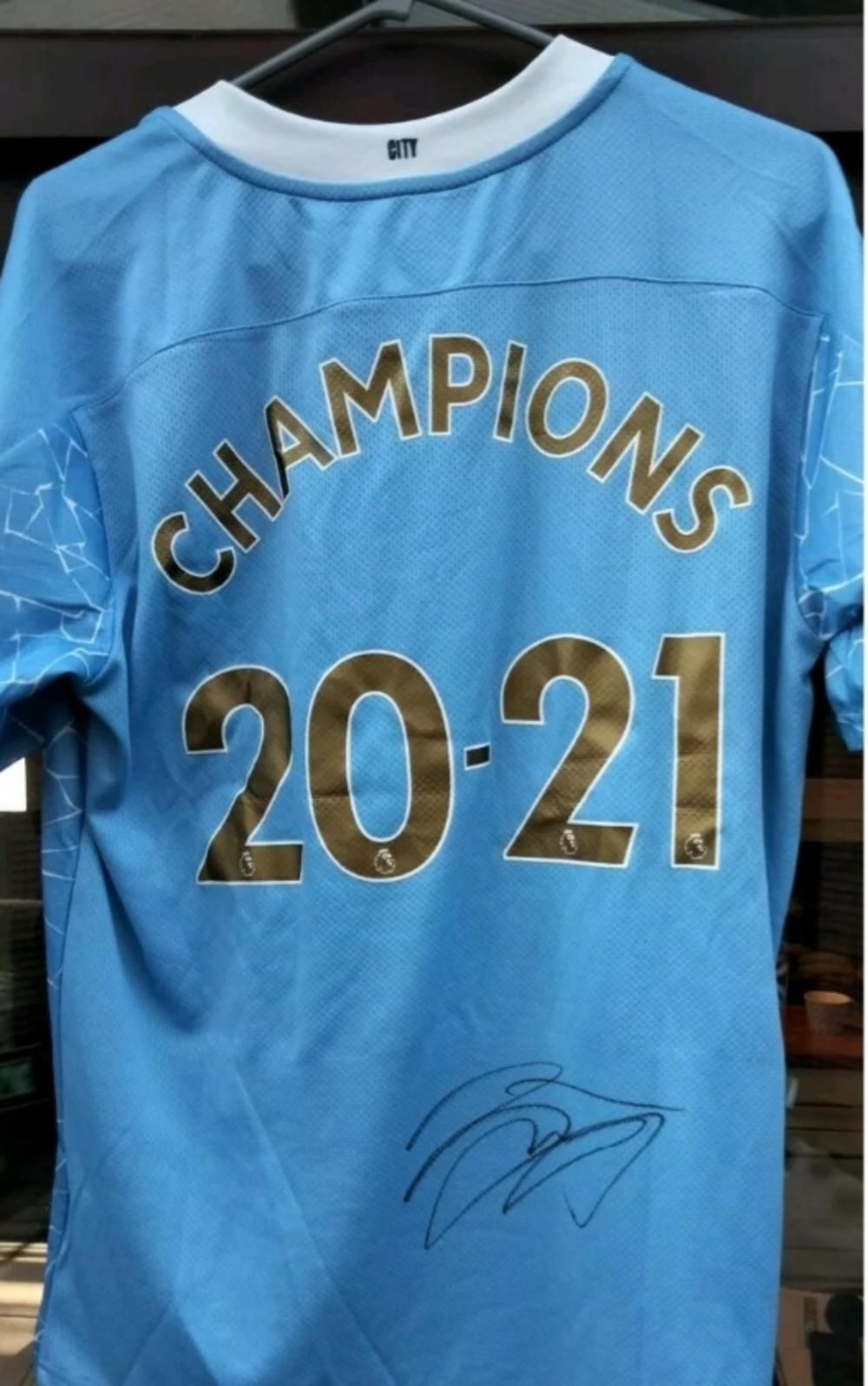 Lot 70 - Oleksandr Zinchenko - Signed Manchester City Football Shirt - direct from the Club. 2010 - 2011 Champions on the back of the shirt.