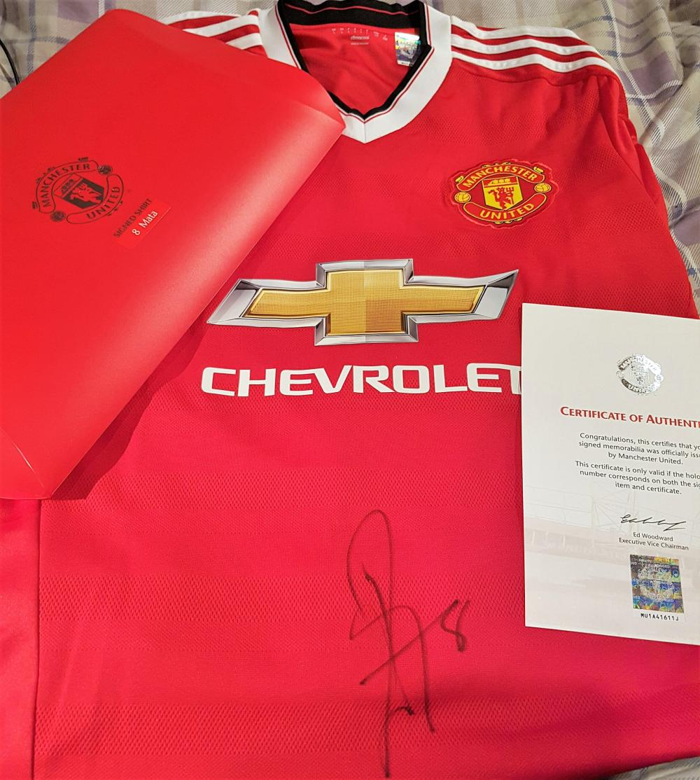 Lot 18 - Signed Manchester United Football shirt by Juan Mata. Juan Manuel Mata Garca orn 28 April 1988) is a Spanish professional footballer who plays as a midfielder for English club Manchester United and