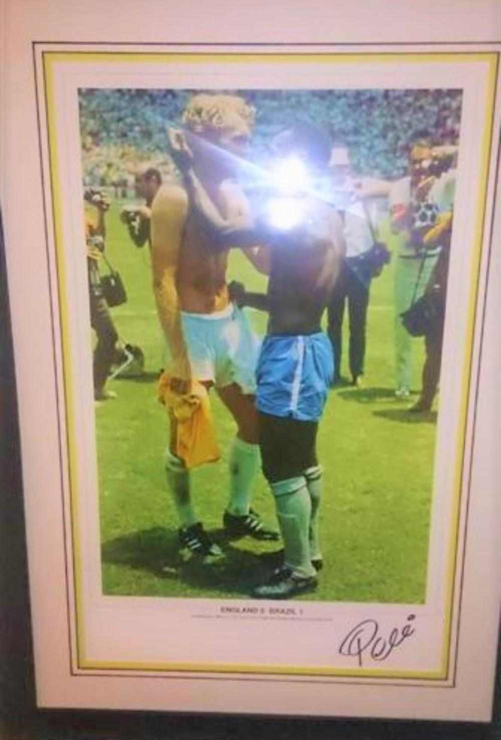 "Lot 20 - Signed Pele and Bobby Moore framed picture - SIGNED BY PELE ONLY.  Robert Frederick Chelsea """"Bobby"""" Moore OBE (12 April 1941 and 24 February 1993) was an English professional footballer. He captained West Ham United for more than ten years"