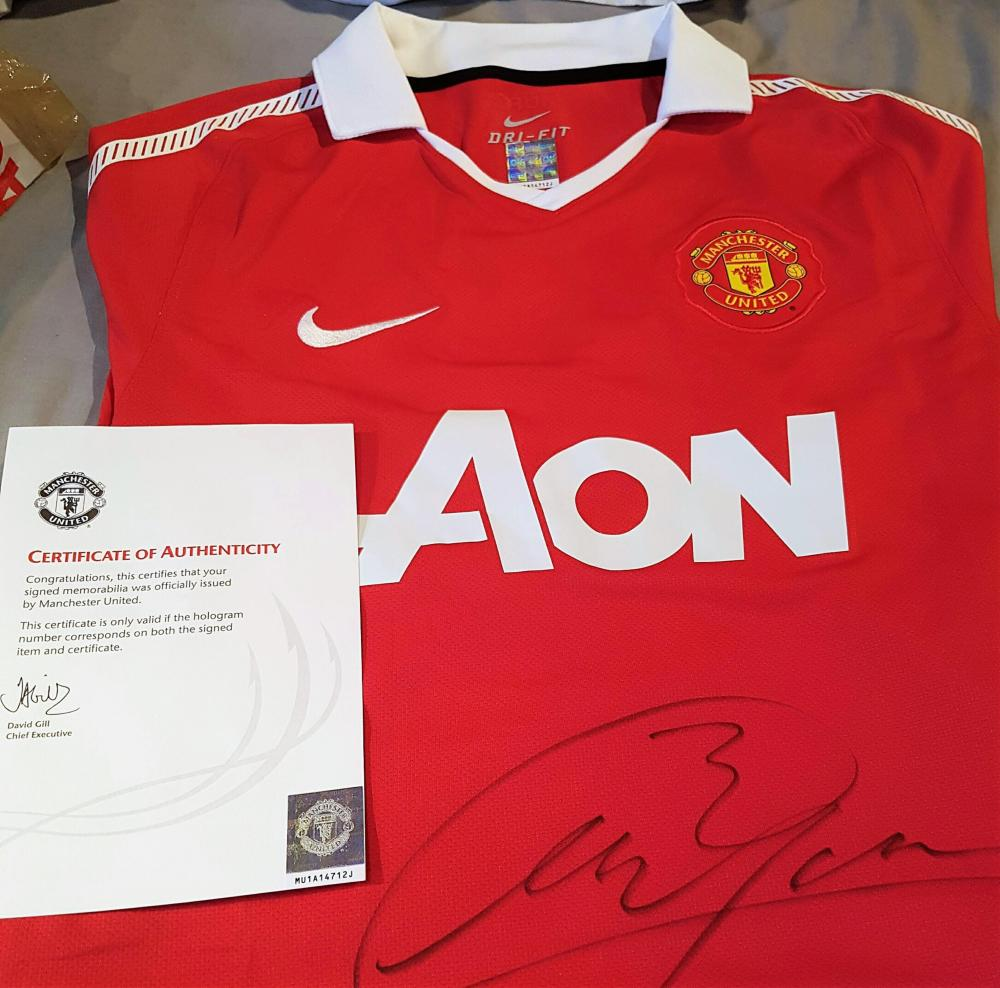 Lot 25 - Signed Manchester United Football Shirt Collection x 4 (Defenders).  Rio Ferdinand,  Patrice Evra,  Phil Jones  & Chris Smalling   All from the Club, some with red presentation cases