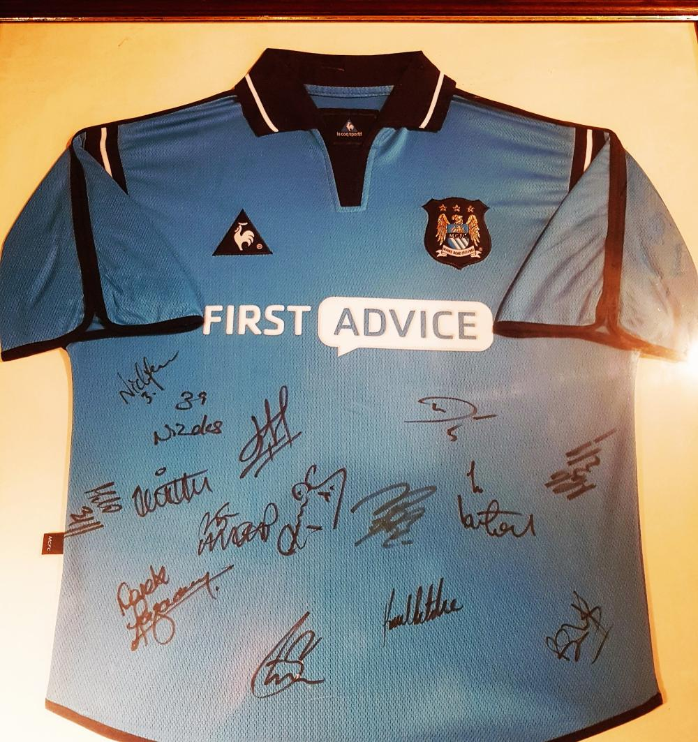Lot 78: Signed and framed Manchester City Team Shirt