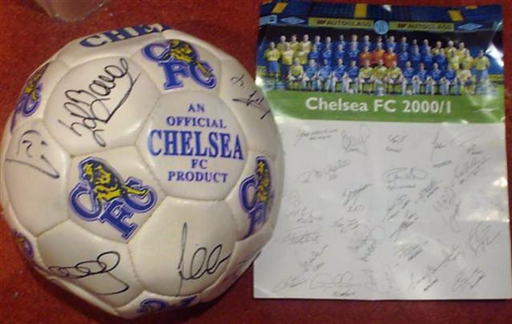 Lot 84 : Chelsea football from the 2000 2001 Season.  Comes with Chelsea Football Team photo card with printed players signatures.