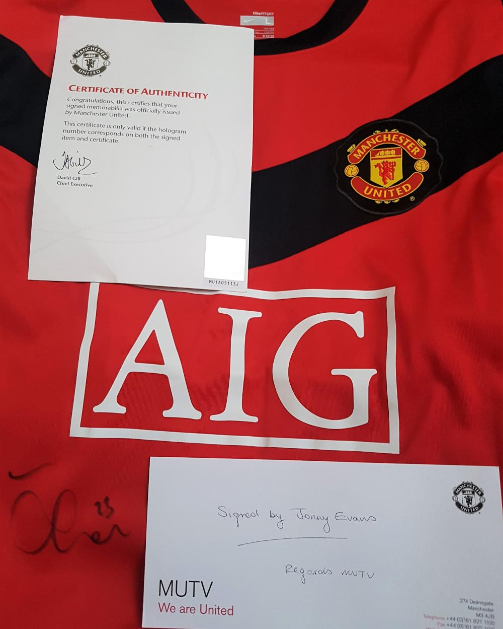 Lot 113: Signed Manchester United Shirt by Johnny Evans