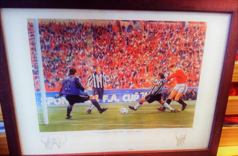 Lot 39 - Signed Print from the Treble Season Part 2 Teddy Sheringham scoring against Newcastle in the FA Cup Final
