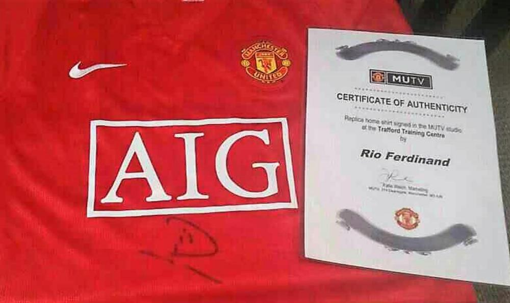 Lot 143: Manchester United Rio Ferdinand Signed Football Shirt from MUTV - Rio Gavin Ferdinand (born 7 November 1978) is an English former professional footballer and current television pundit for BT Sport who played as a centre-back. He played 81