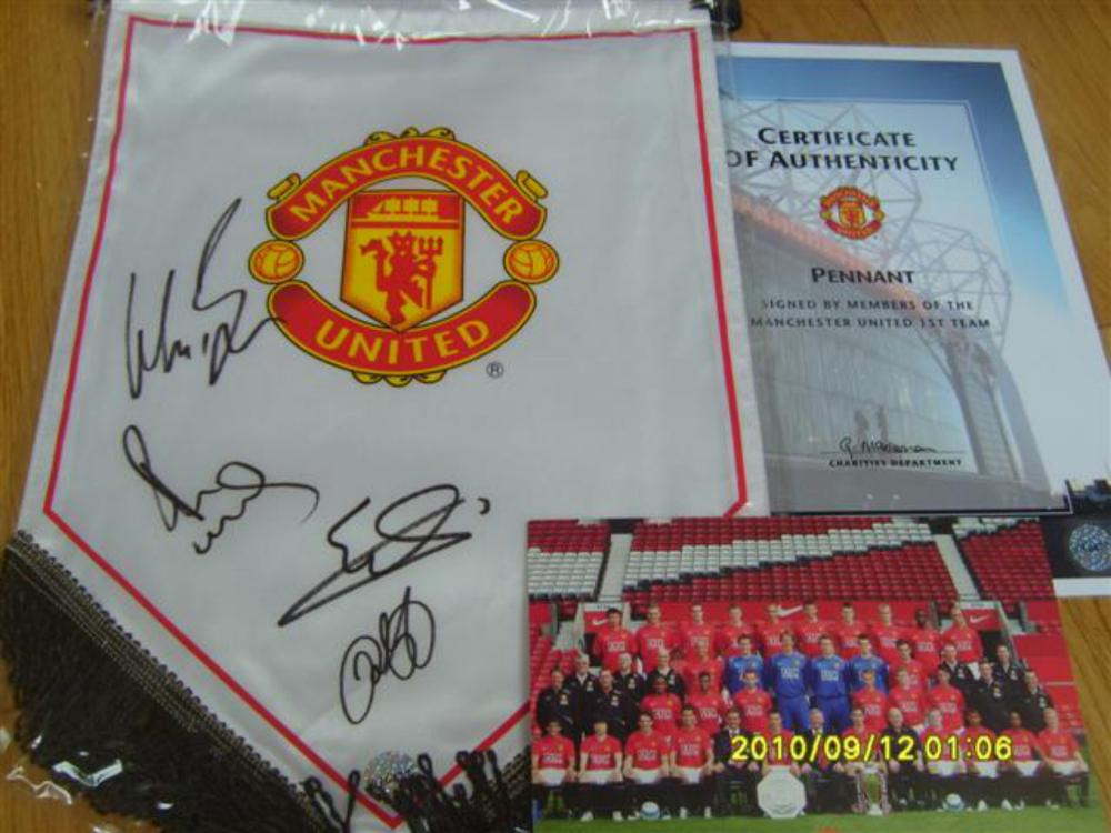 Lot 159: Manchester United Official Signed Pendant - Signed by 4 players,  Wes Brown   Paul Scholes,  Edwin Van Der Sa   and Ryan Giggs