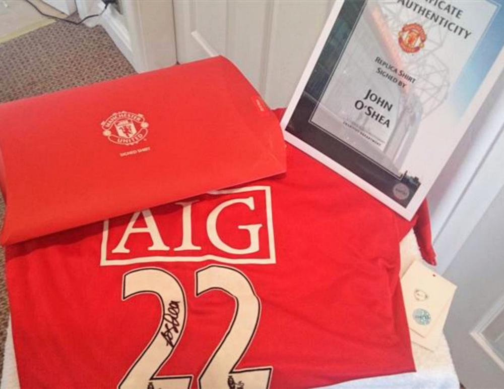 Lot 171: 2008/09 Manchester United Home Shirt - Hand Signed by John O'Shea. A perfect gift for any Manchester United or Ireland fan. . This is a fantastic opportunity to own a signed John O'Shea Manchester United shirt. It's brand new with security