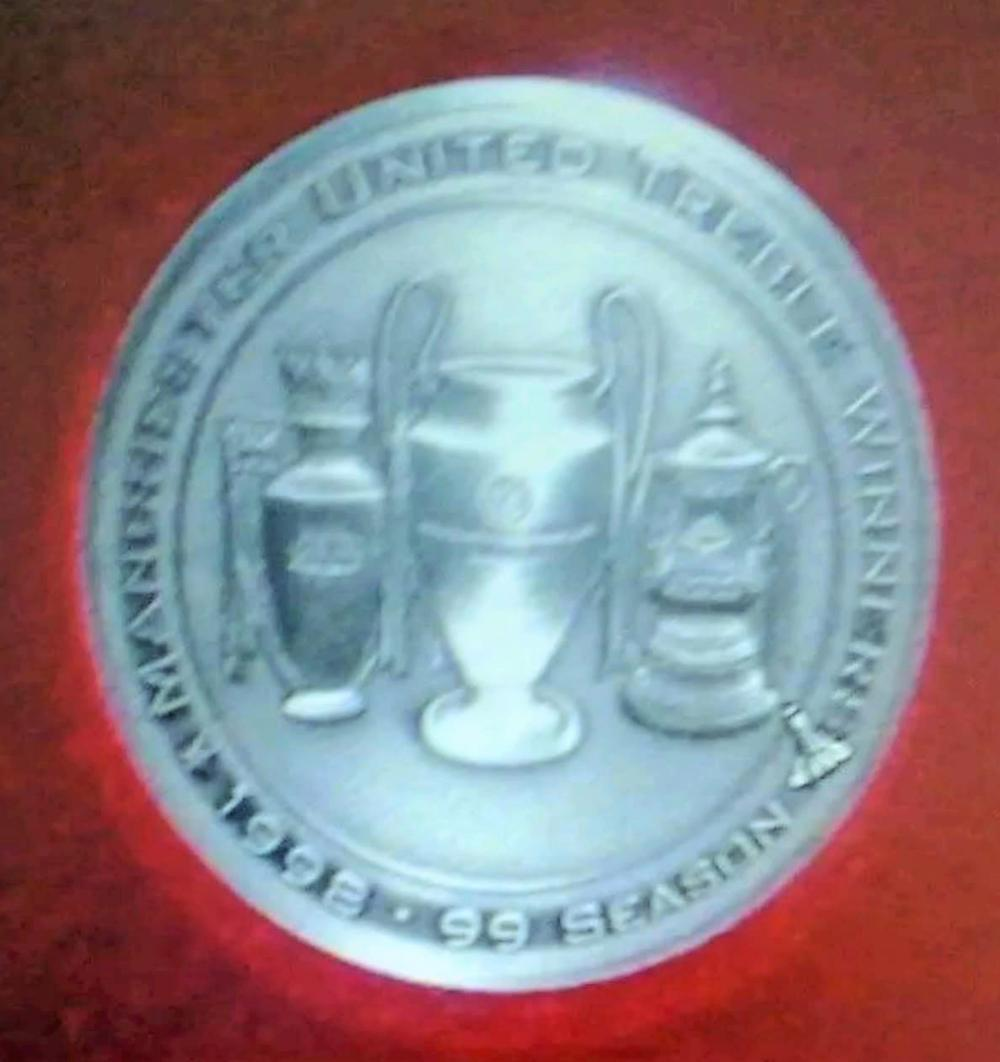 Lot 166: Treble Coin in Display Case - The 1998?99 Season was the most successful season in the history of Manchester United Football Club. After finishing the previous season without winning any titles, United won a treble of trophies (the Premier