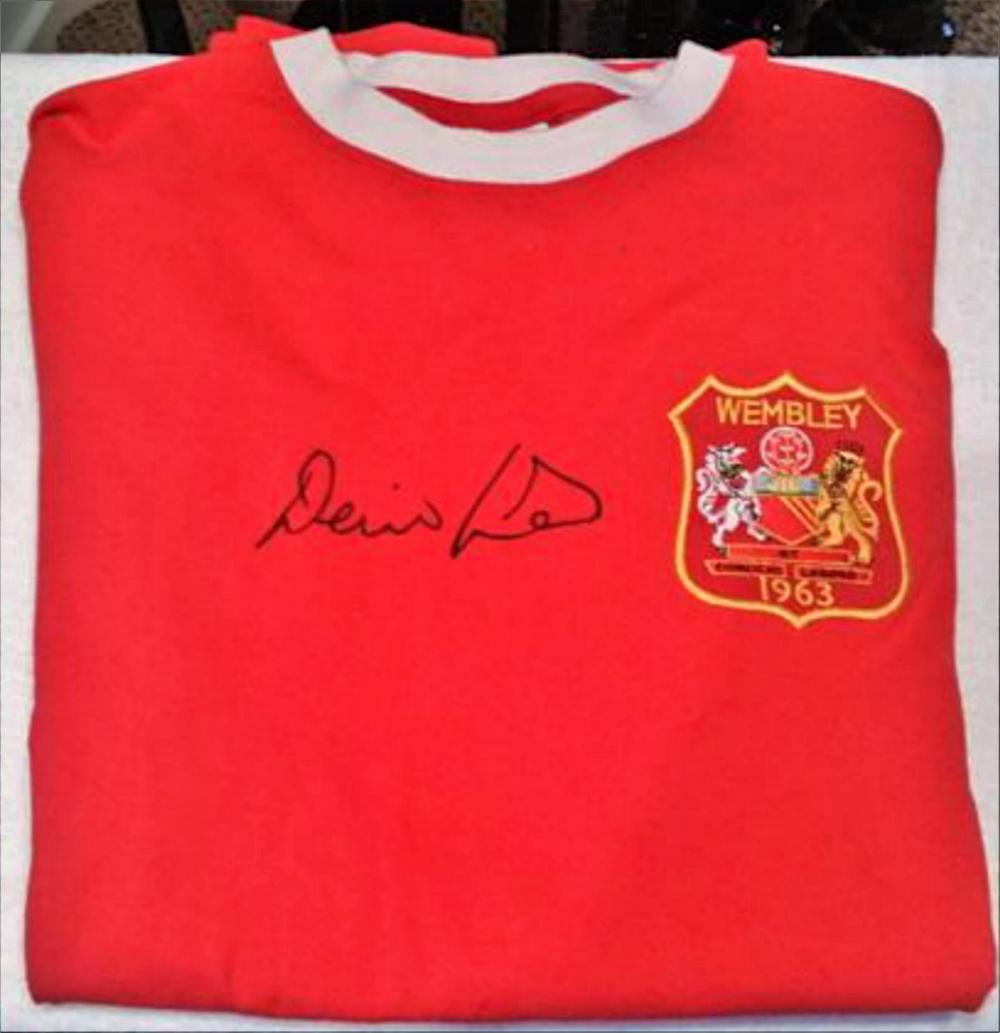 Lot 170: Denis Law Signed Football Shirt - Manchester United and Scotland LEGEND.  Denis Law was nicknamed The King and The Lawman by supporters, and Denis the Menace by opposing supporters. He won the Ballon d'Or award, doing so in 1964.