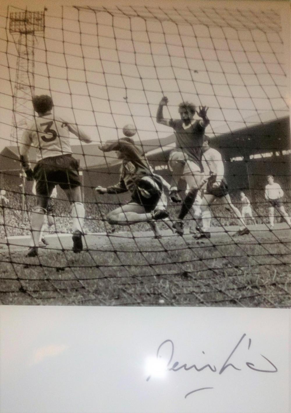 Lot 187: Denis Law Manchester United and Scotland Signed Photo - Law spent 11 years at Manchester United, where he scored 237 goals in 404 appearances. His goals tally places him third in the club's history, behind Wayne Rooney and Bobby Charlton. He
