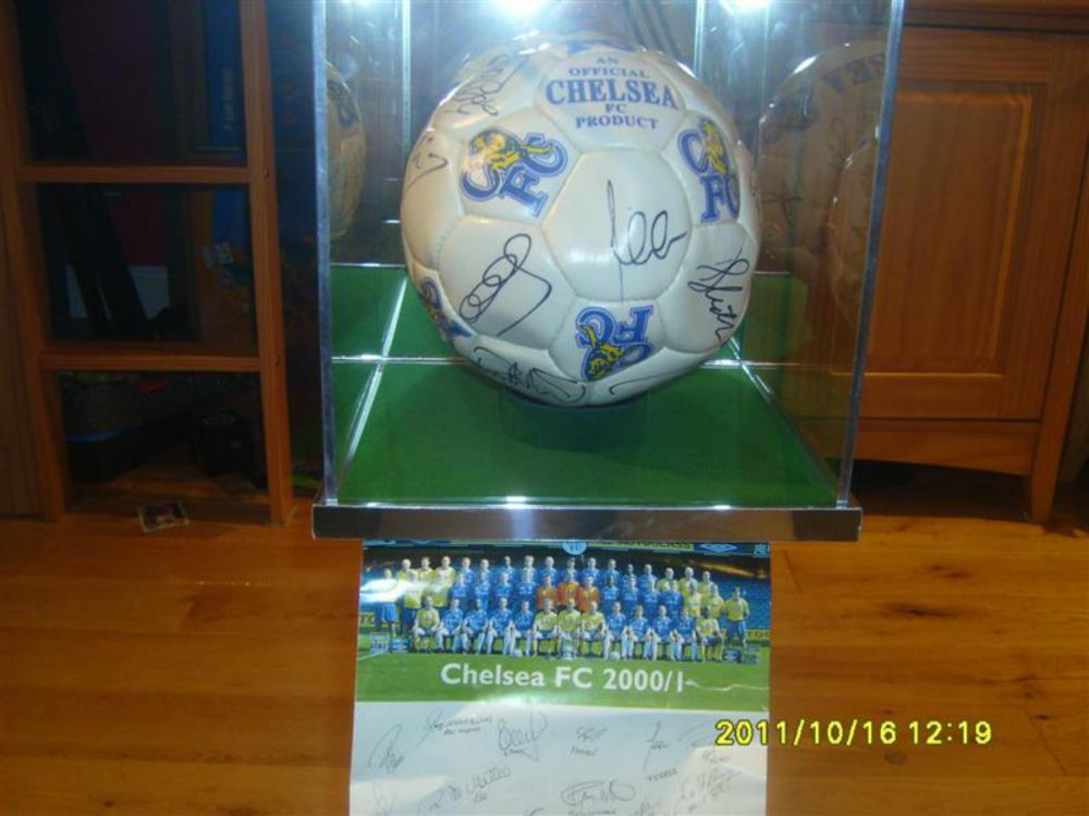 Lot 200: Chelsea football from the 2000 2001 Season.  Comes with Chelsea Football Team photo card with printed players signatures.