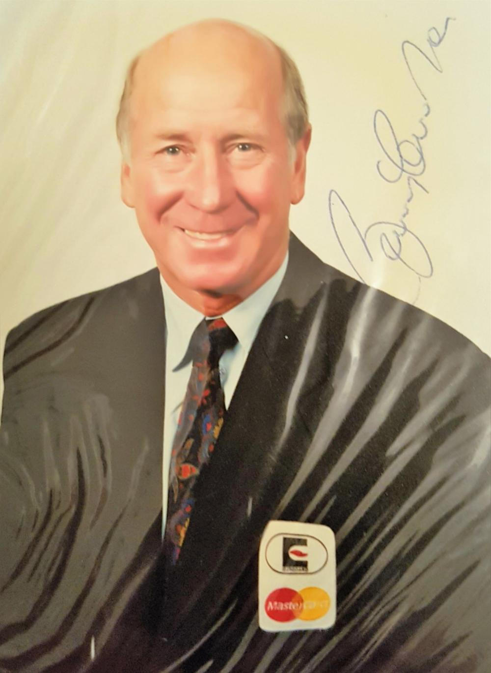 Lot 222: Sir Bobby Charlton signed mastercard promo photo