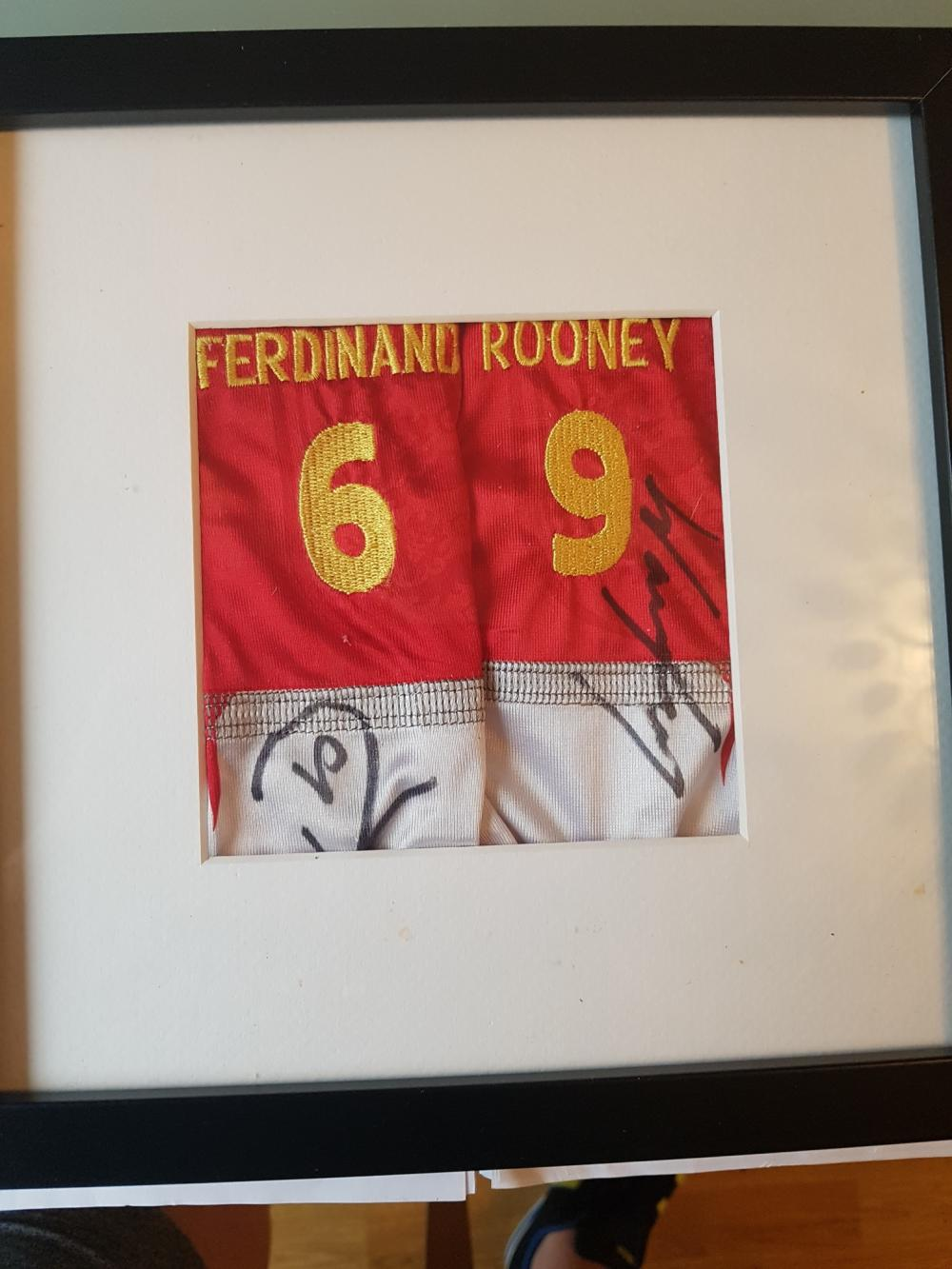 Lot 233:  Rio Ferdinand and Wayne Rooney Framed Mcdonalds Mini Football kit