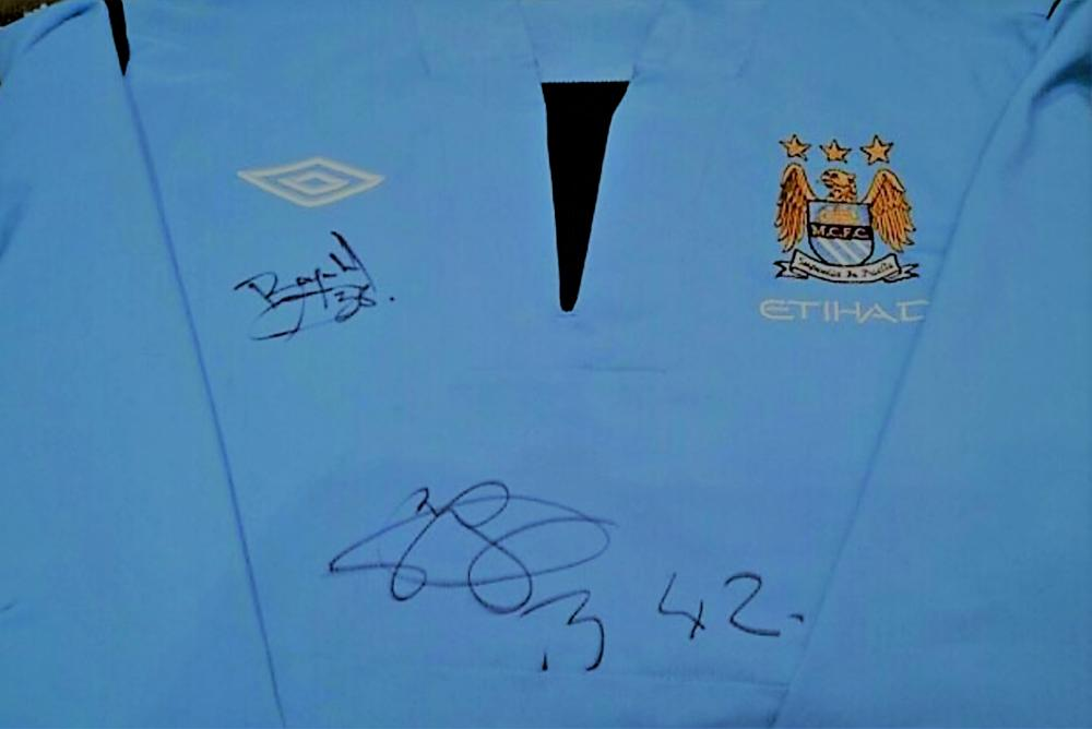 Lot 231: Yaya Toure Signed Manchester City Training jacket -