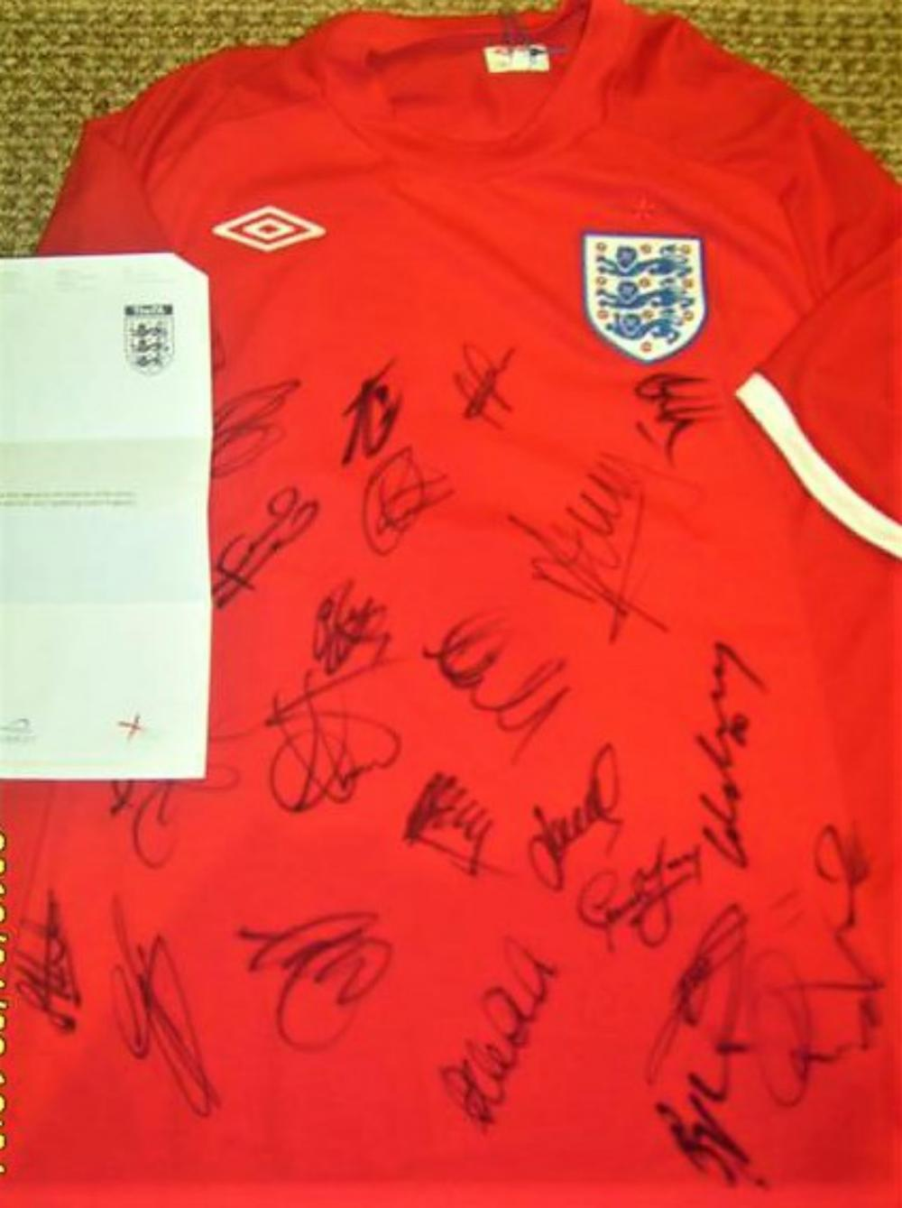 Lot 259: Team Signed England Shirt (No 4) - 2012 Shirt signed by the senior players who playered in the Qualifying game against England v Switzerland - Signed by Lampard, Rooney, Barry, Milner, Lennon and many more