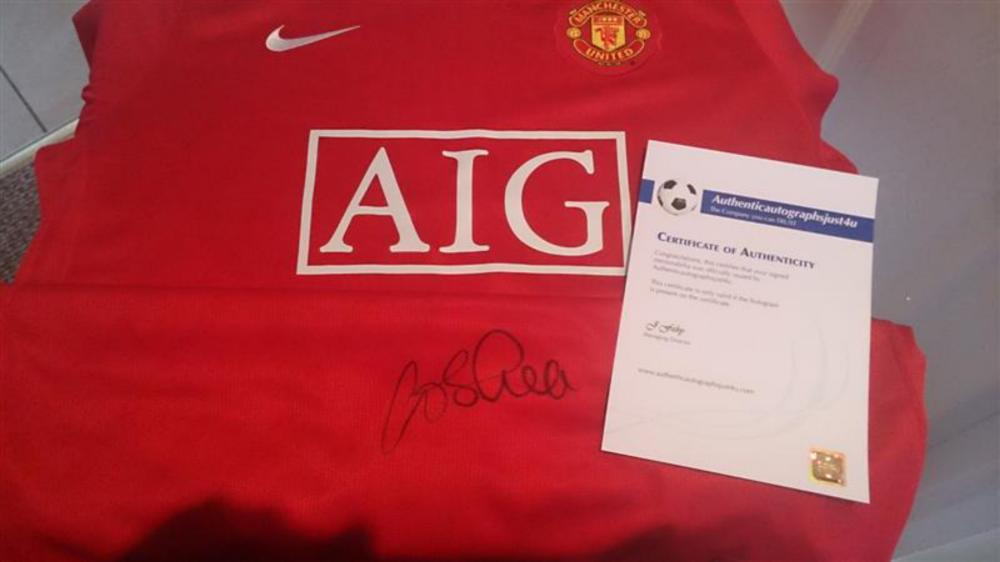Lot 247: John Oshea Signed Manchester United Shirt. John Francis O'Shea (born 30 April 1981) is an Irish footballer, who plays as a defender for Sunderland and the Republic of Ireland national team, where he serves as vice-captain. He is