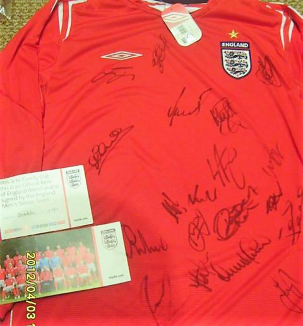 Lot 260: Team Signed England Shirt No 5 - Signed by Owen, Terry, Lampard, Vassal, Robinson, Green, Charlton Cole and many more