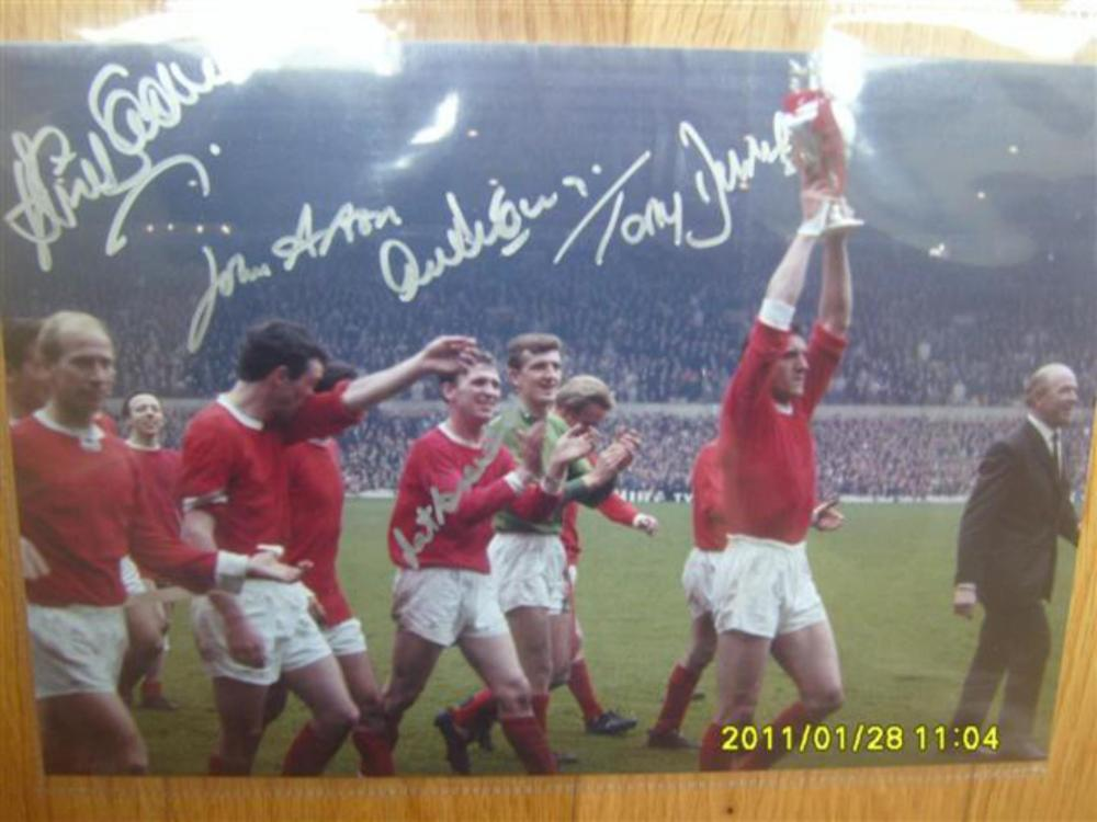 Lot 301: Signed Photo of retired Manchester United Team Winning Trophy - Tony Dunne, John Aston, David Sadler and one more