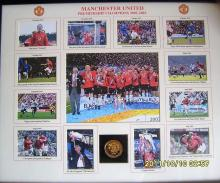 Lot 197: 2001 Manchester United League winners picture, showing pictures from the winning season. Contains gold medal to celebrate the success.  Direct from Manchester Uniteds Superstore - Large heavy item best to collect