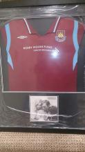 Signed and Framed Bobby Moore West Ham Shirt display