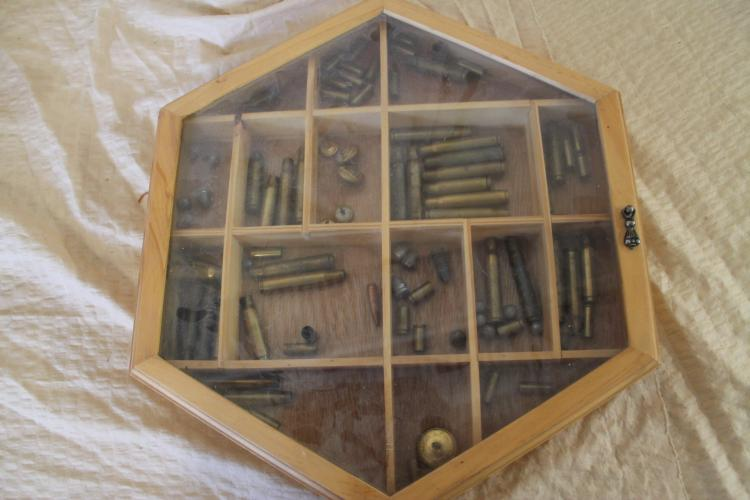 Display case full of brass shells and lead bullets