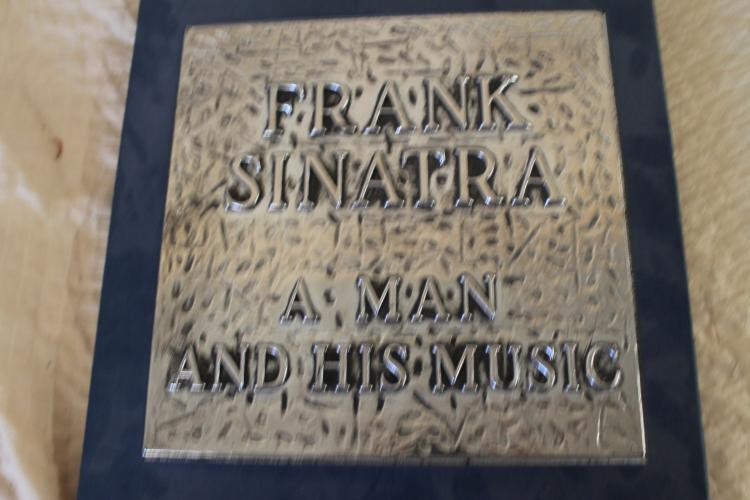Sinatra and his music album