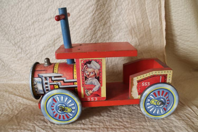 Wooden train with tin wheels