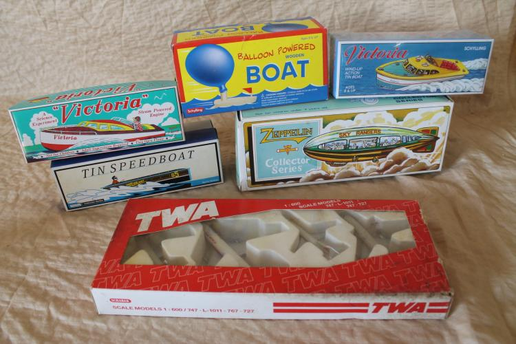 Lot of tin toy boats and aircraft