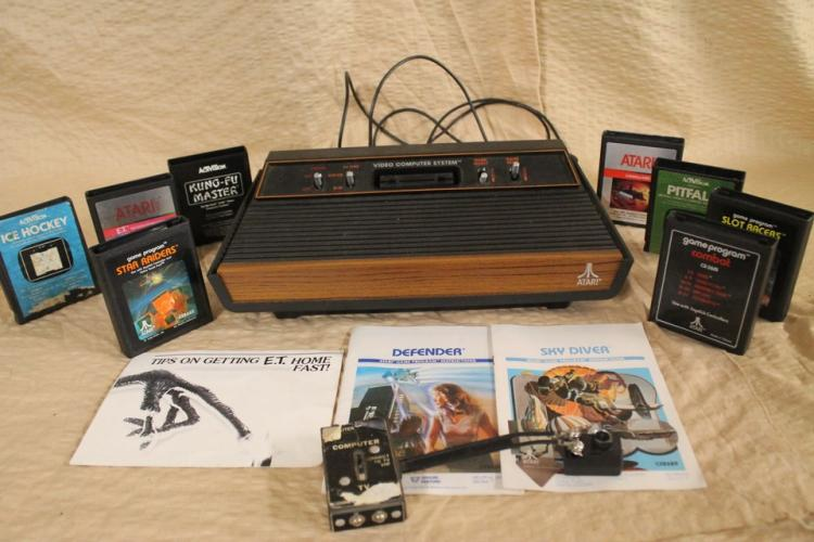 Atari 2600 console with games and instruction booklets