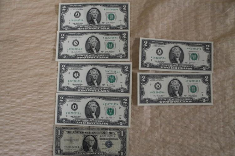 One $1 Silver certificate and six $2 bills