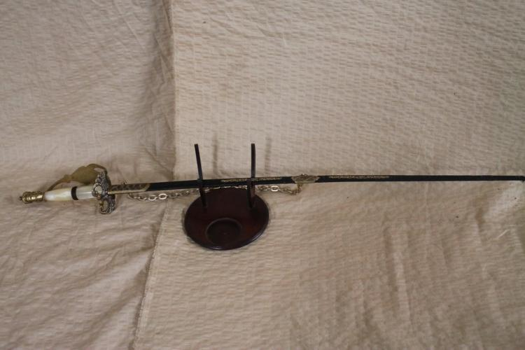 Mother of pearl handled antique sword