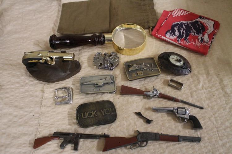 Lot of belt buckles and miniature guns